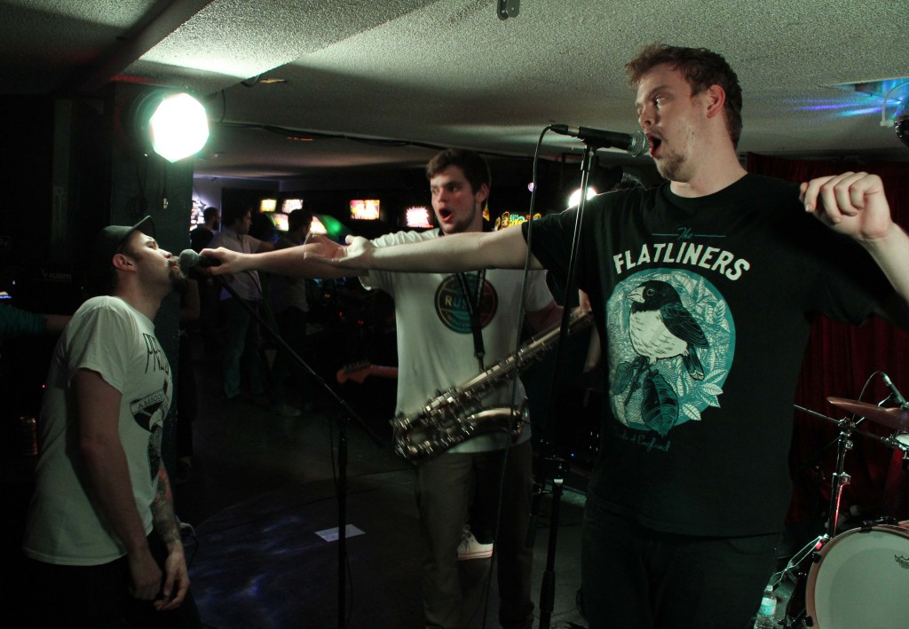 Suits 'n Toques passing the mic to JS to sing along at House of Targ's one year anniversary. Photo: Eric Scharf