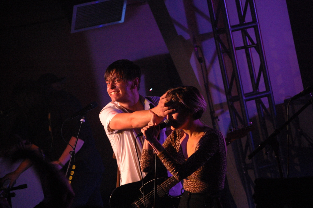 Peter Dreaimanus covering Leah Fay's eyes while she sings. Photo: Eric Scharf
