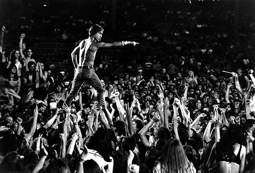 Iggy Pop (lead singer of The Stooges) just standing on the crowd like it is no big deal.