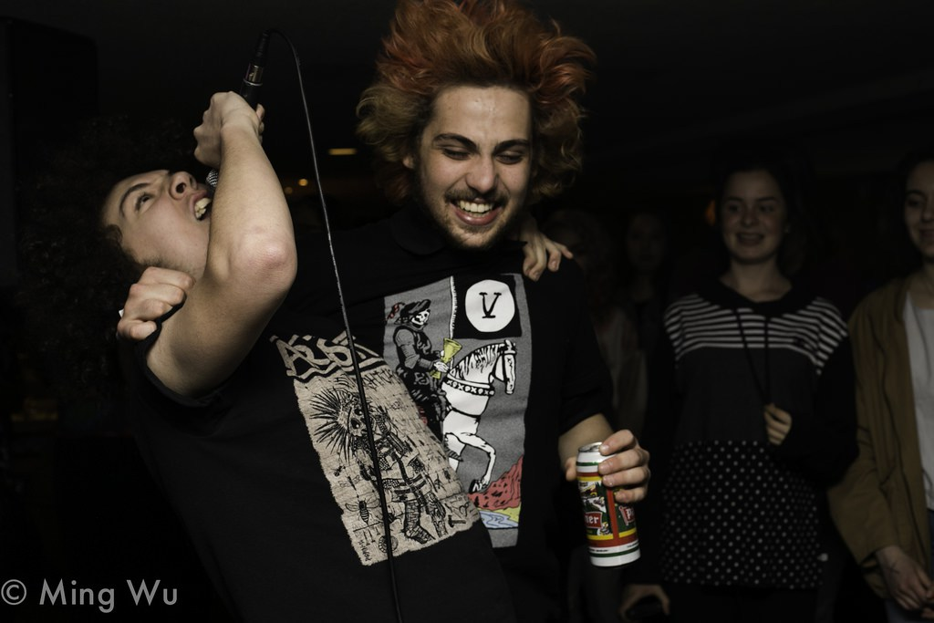 Felix of Toxic Thoughts in the crowd raging with a fan during their set at House of Targ. Photo: Ming Wu