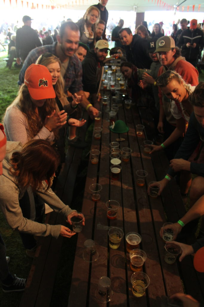 Festival goers honing their flip cup skills at Beau's Oktoberfest 2016. Photo: Eric Scharf